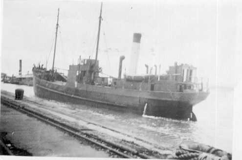 1903 general cargo vessel entering port