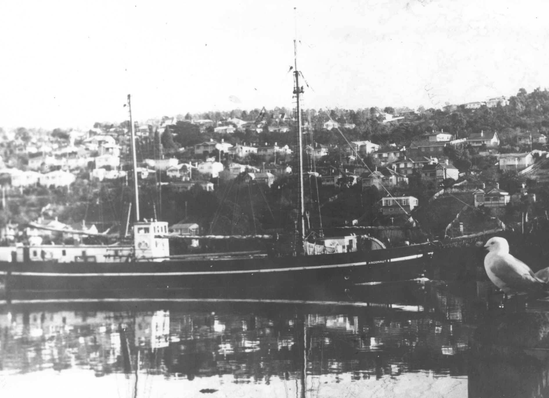 In this image vessel is moored at a harbour, showing a side on view of vessel.