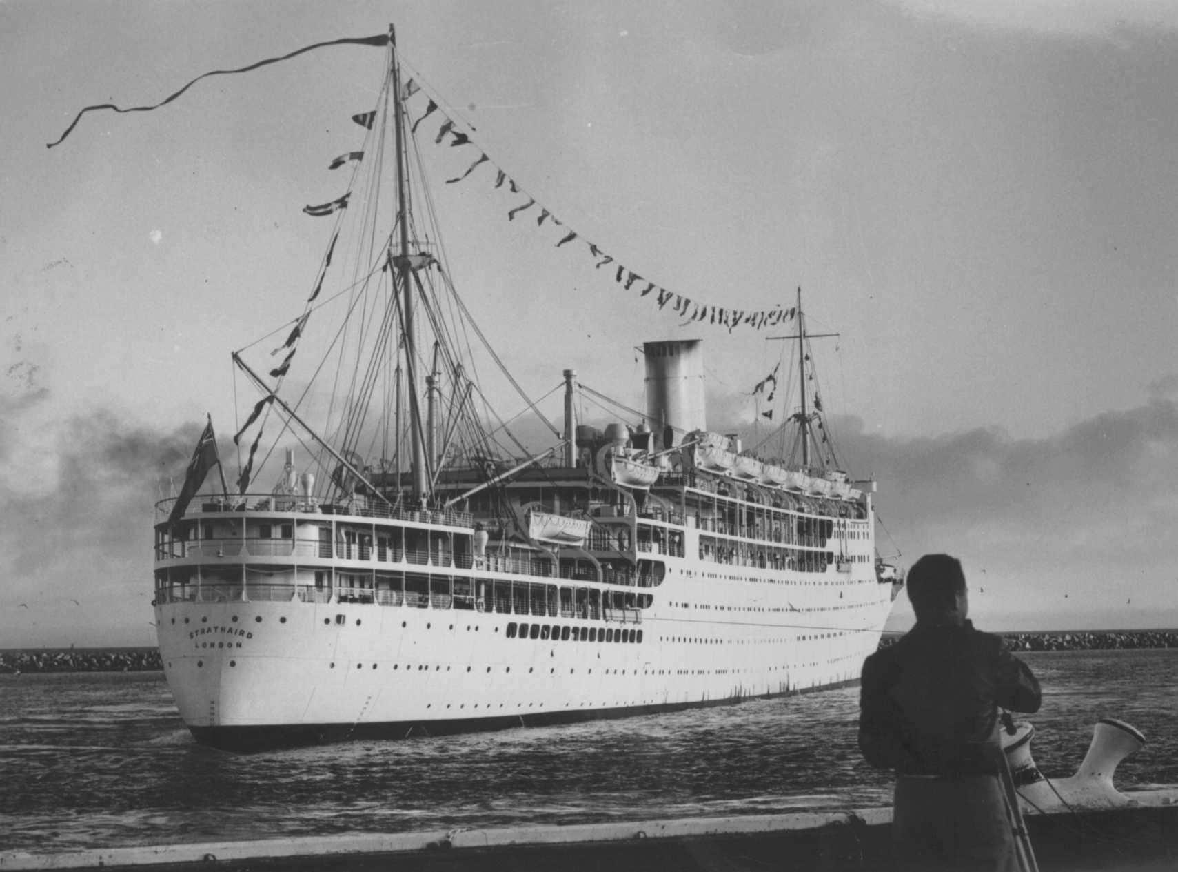 1931 passenger vessel. This image shows vessel with flags flying, leaving for UK and breaking up, 15/5/1961.