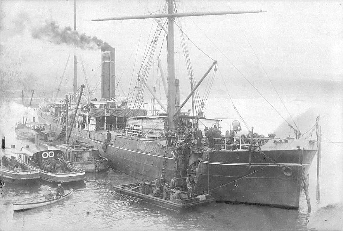 """Freighter, S.S. """"Argus"""", built in 1889 at Newcastle, UK, and employed in Australia to India trade.  Owned from 1889 unitl 1905 by Archibald Currie, then sold into Japan.  Vessel has a gross tonnage of 2792.  This image shows vessel  ashore at Goat Islan"""