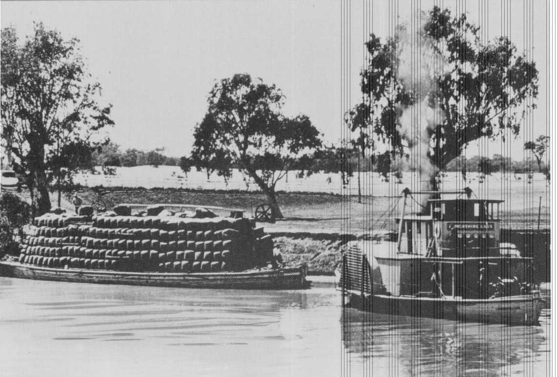 Paddle steamer and barge