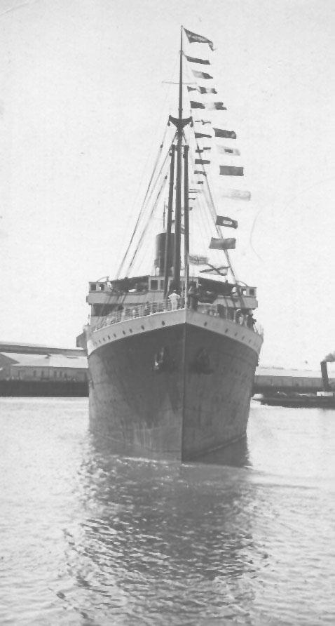 1909 passenger vessel. This image shows vessel leaving Port Adelaide under tow from tug S.S. Falcon and with flags flying.