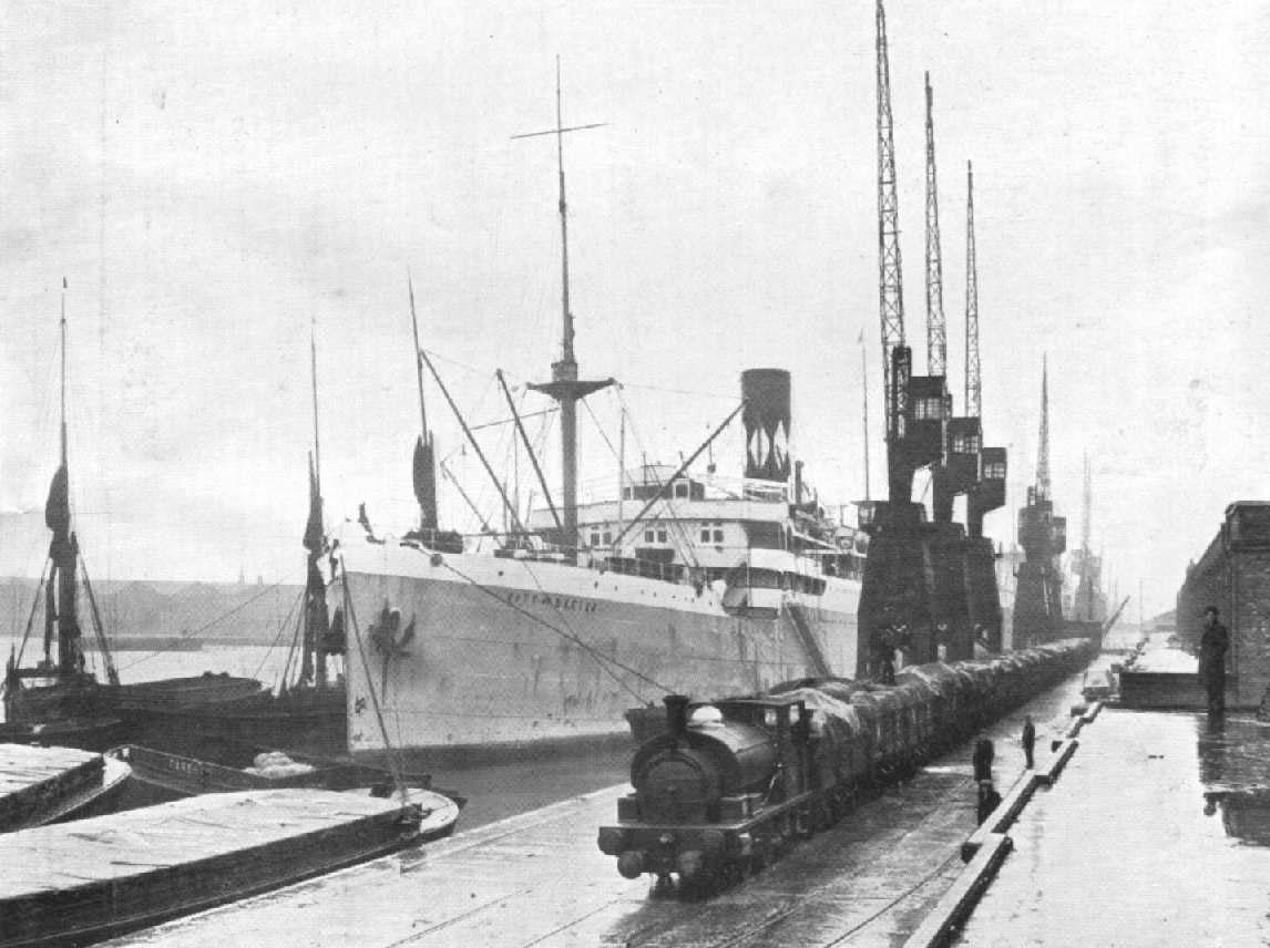 1914 passenger cargo vessel berthed