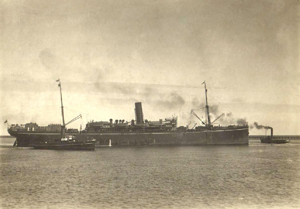 Image: large steamship with tug boats in water
