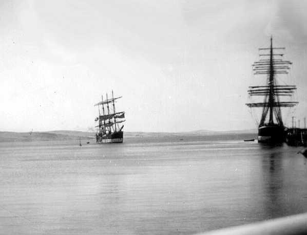 """This image shows vessels at Port Lincoln, SA.  """"Lawhill"""" beside the jetty and """"Pamir"""" further out, January 1937."""