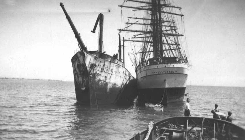 """Under tow together.  4 masted Barque """"Herzogin Cecilie"""", built in 1902 at Bremerhaven by Rickmers for Norddeutscher Lloyd.  Built as a training ship, she had an enormous poop of 194' and carried a big spread of canvas.  She was steered from a midships w"""