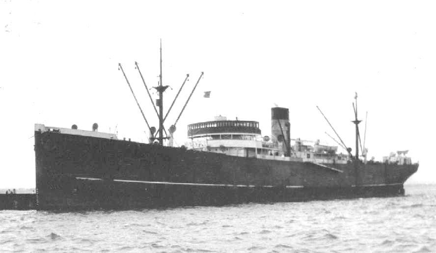 1931 general cargo vessel under tow.