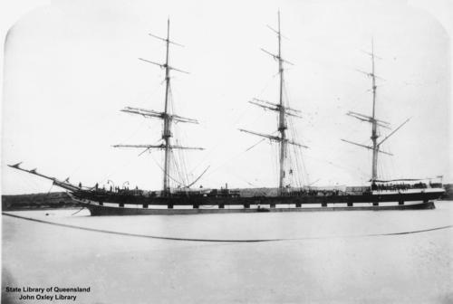 Image: three masted ship, sails furled