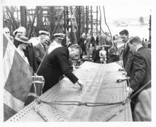 At Cockatoo Dockyard, Sydney, 16 February 1940, showing Mr. Menzies putting a rivet in the keel of ship under construction.