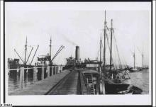 """Port Victoria Jetty, the Ketch """"MacIntyre""""at the Jetty  ca.1920."""