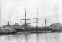 """Three masted Barque """"Onyx"""", built in 1864 at Sunderland by J Laing.  Owned by H Guthrie. Official Number:  51153 Tonnage:  420 gross Dimensions;  length 137', breadth 26', draught 17' Port Of Registry:  Dunedin  This image taken in Dunedin"""