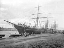 A steel screw steamer, also rigged as a Barque.  Built in 1882 at Greenock by Scott & Co for China Navigation Co Ltd. Official Number:  86981 Tonnage:  1734 gross Dimensions:  length 271', breadth 34', draught 24' Port Of Registry:  London Machinery: