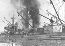 """General cargo vessel """"City Of Singapore"""", built in 1923 at West Hartelpool by Wm Gray & Co for Ellerman Lines Ltd.  On 26 - 4 - 1924 at 10pm the tragic scene at No 2 Quay, Port Adelaide, where the petrol laden """"City Of singapore"""" exploded.  Explosives abo"""