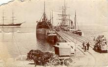 Port and harbour scene showing jetty and shipping