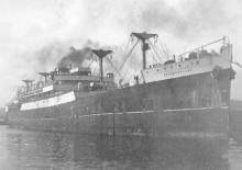 1917 Steamer, under tow.