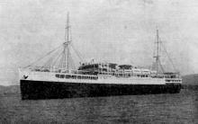 1928 passenger vessel entering port